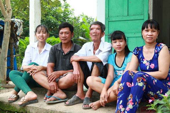 Dinh Thi Kim Thuy (first on the left) sits with her family in Tra On District, Vinh Long Province, southern Vietnam. Photo: supplied
