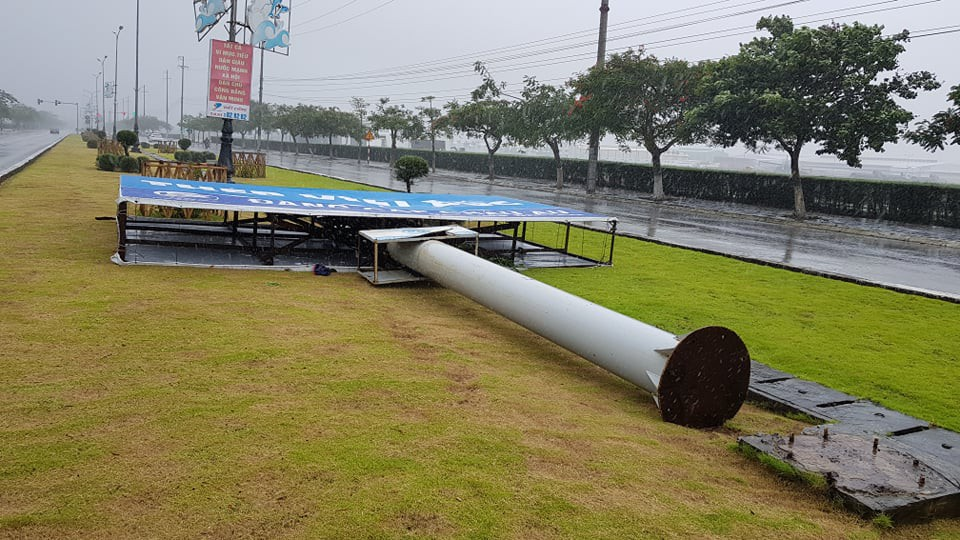A billboard is knocked down in Hai Phong City. Photo: Tien Thang / Tuoi Tre