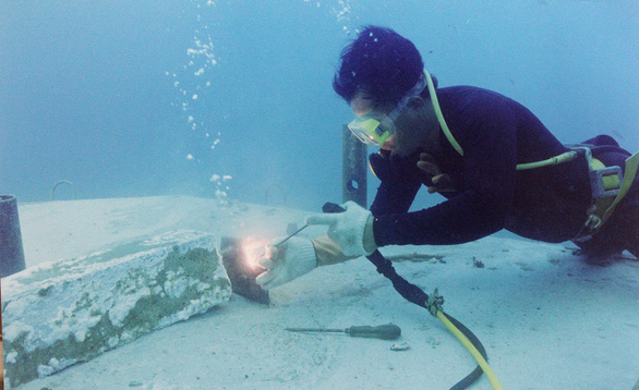 A diver examines the foundation of a DK1 rig in this file photo.