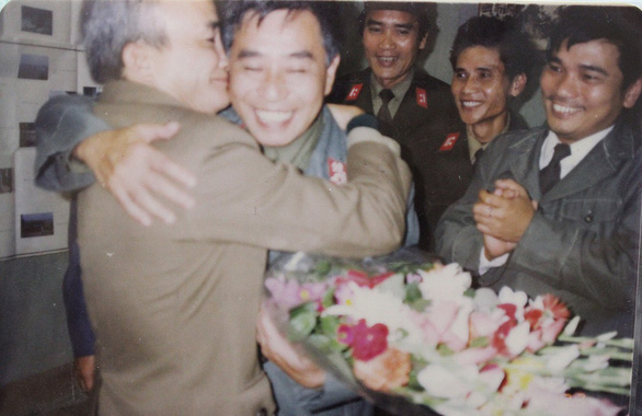 Army engineers embrace each other upon learning that the first DK1 rig had been successfully installed in 1989 in this file photo.