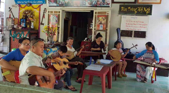 On Saigon's outskirts, people from all walks of life gather to learn traditional music instruments