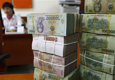 Vietnam looking at relaxing FX hedging curbs: official
