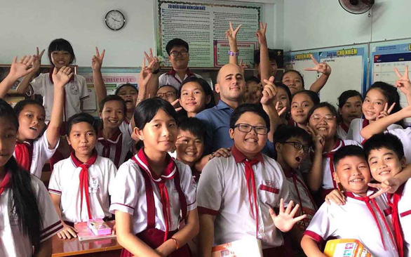 Raphael Galuz, a Frech expat, poses for a photo with his Vietnamese students at an elementary school in Ho Chi Minh City in this photo provided by himself.