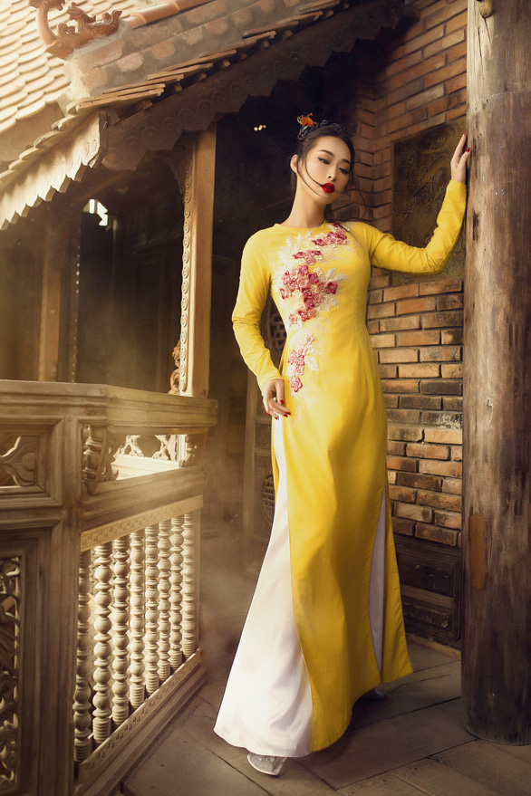 Vietnamese model Quynh Thy is pictured wearing an ao dai in the Xuan Thi collection by Vo Viet Chung. Photo: Supplied