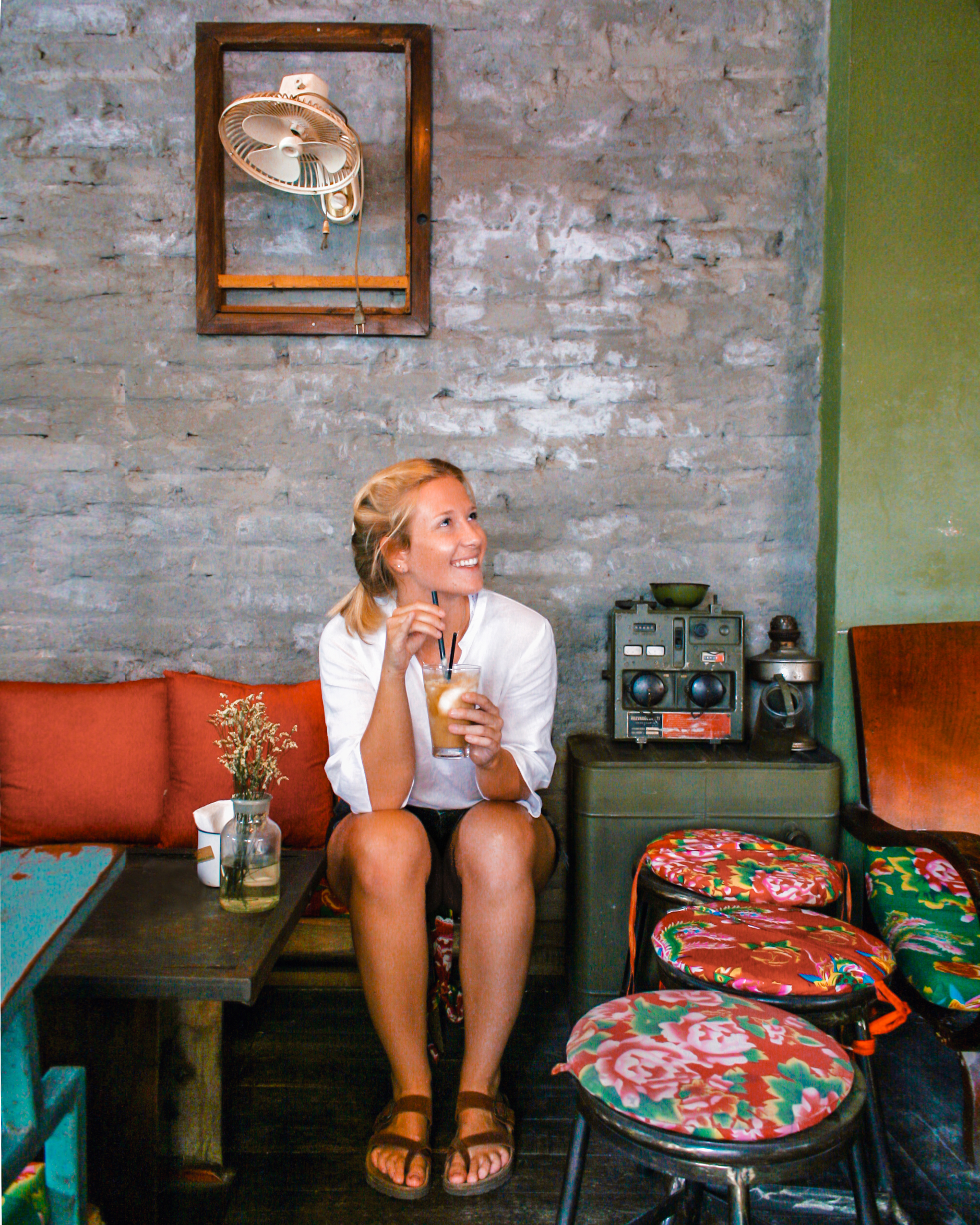 Kelsey Madison enjoys Vietnamese coffee at a coffee shop in Hanoi. Photo: milesofsmiles.co