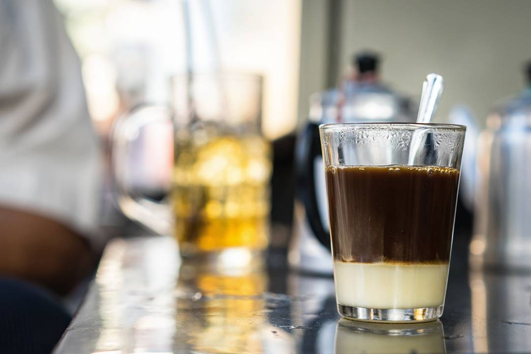 A glass of ca phe sua (coffee with sweet condensed milk) outside Tan Dinh Market in Ho Chi Minh City is seen in a photo taken by Swede photographer Tanya Olander. Photo: @somewheresaigon