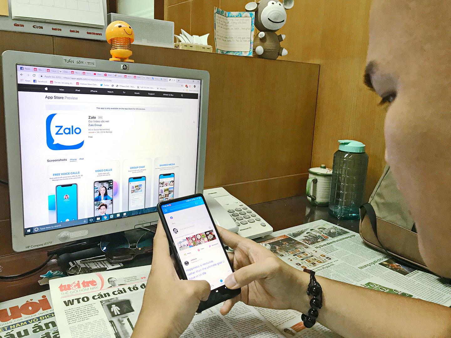 A journalist trials a Zalo mobile app at his newsroom in Ho Chi Minh City, July 19, 2019. Photo: Son Luong / Tuoi Tre News