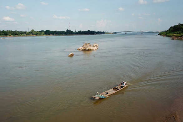 Low water levels are seen on a section of the Mekong River in Thailand, revealing a stone believed to carry the footprint of Buddha. Photo: Bangkok Post