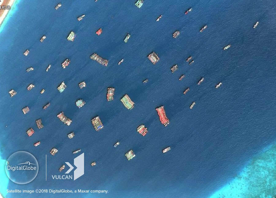 Chinese fishing vessels are seen at Xu Bi (Subi) Reef in Vietnam's Truong Sa (Spratly) archipelago on August 12, 2018 in this satellite photo provided by DigitalGlobe, Inc. and Vulcan Technologies LLC to the Asia Maritime Transparency Initiative.