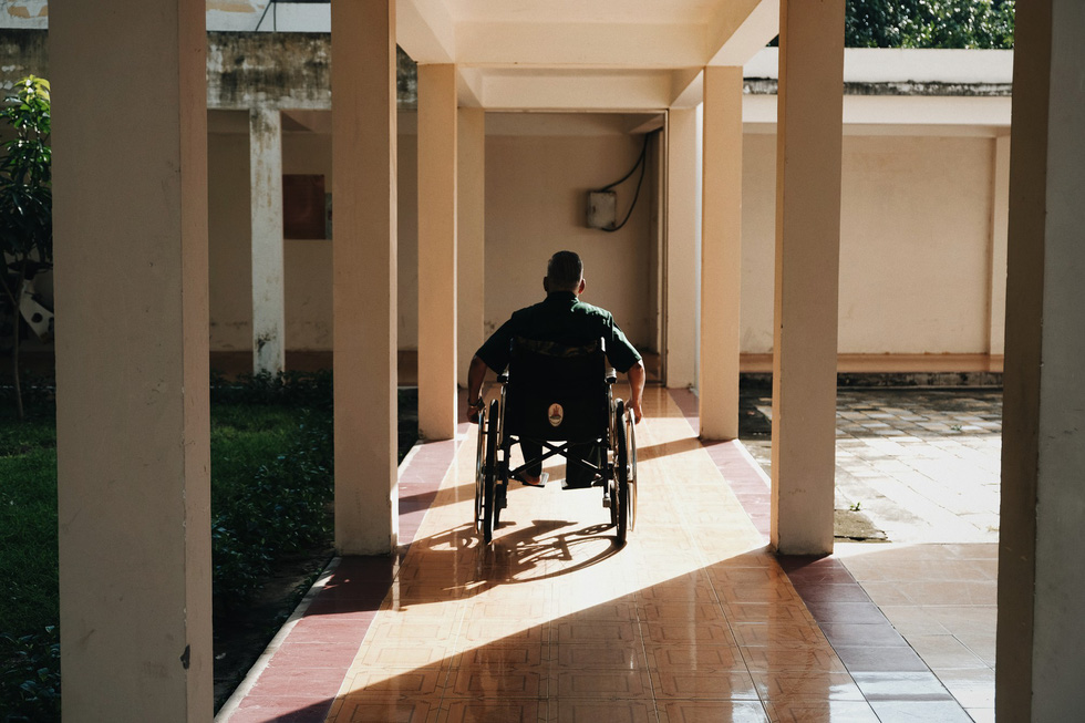 A post-war invalid moves around on a wheelchair at the Long Dat Wounded Soldiers' Nursing Center located in Ba Ria – Vung Tau Province, southern Vietnam. Photo: Mai Thuong / Tuoi Tre