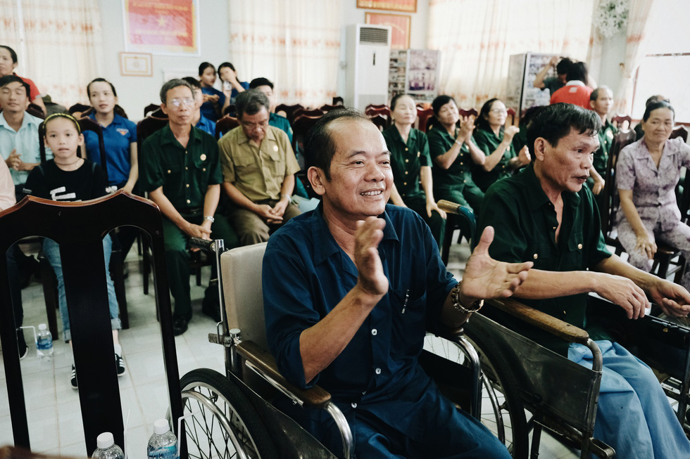 Post-war invalids clap along a song at the Long Dat Wounded Soldiers' Nursing Center located in Ba Ria – Vung Tau Province, southern Vietnam. Photo: Mai Thuong / Tuoi Tre