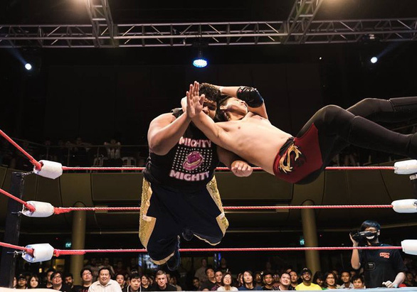 Huynh Cong Hung (left) and his teammate Nguyen Huu Minh Duc perform at a wrestling show in Singapore. Photo: Najwan Noor