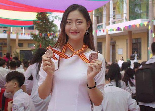 A photo of Miss World Vietnam Luong Thuy Linh taken off her social media when she was still in high school holding two medals for her  academic achievements.