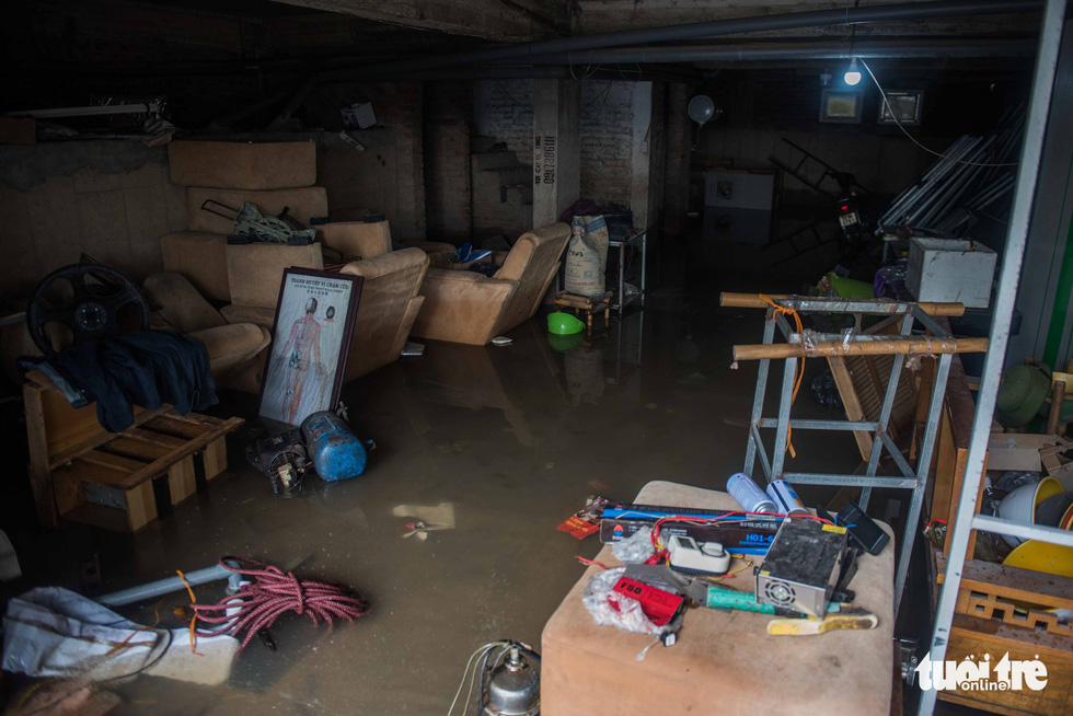 Rainwater submerges a basement of a local house.