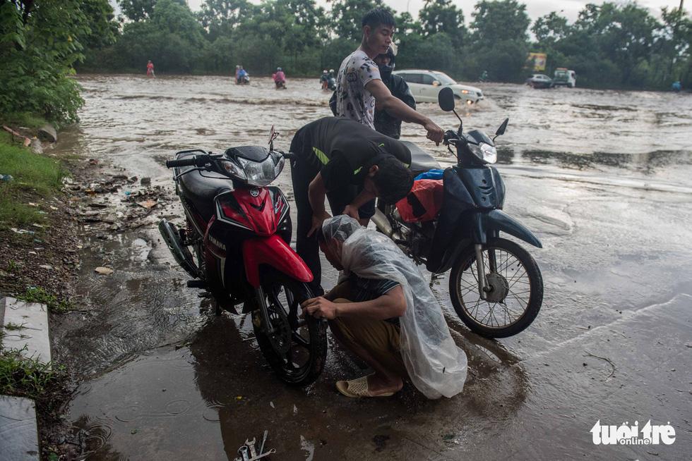 Motorbikes break down due to the inundation.