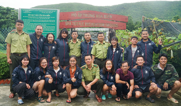 Volunteers pose for a photo with local rangers on Con Dao Island. Photo: Hoang Huy / Tuoi Tre