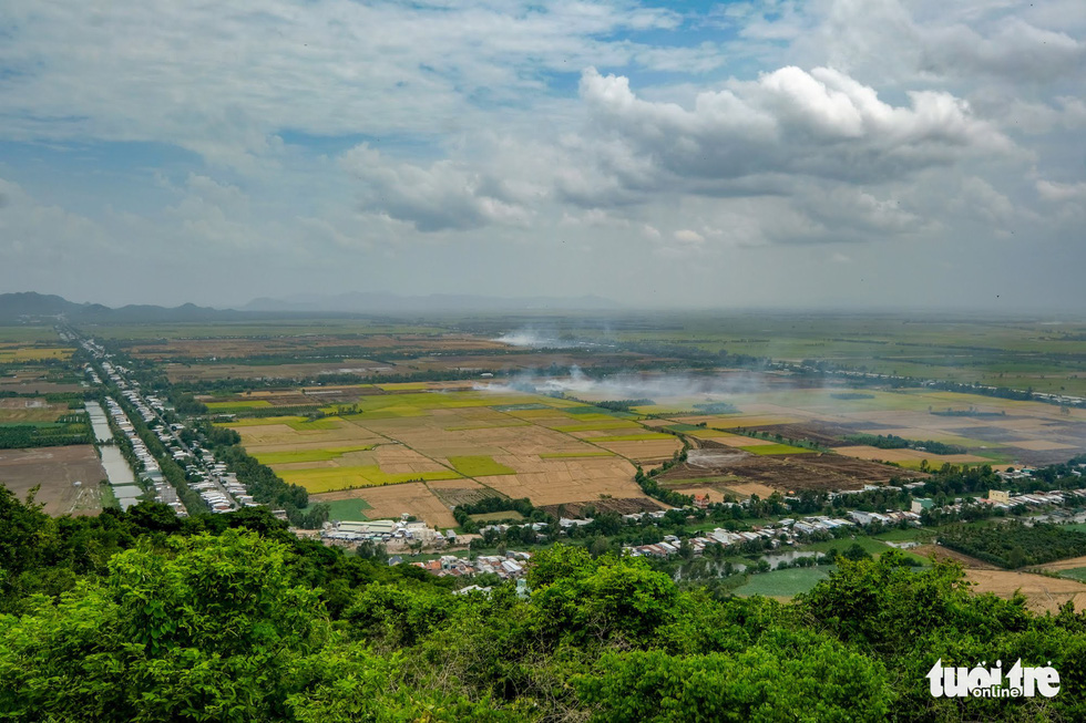 <em>Endless paddy fields stretching to Vietnam's border with Cambodia are seen from atop Sam Mountain. Photo:</em> Tuoi Tre
