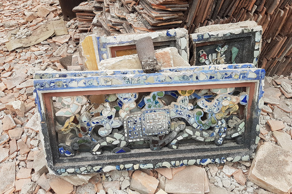 A decoration of Quoc An Temple in Hue, Vietnam is thrown among the rubble at the disassembly site on July 31, 2019. Photo: Thai Loc / Tuoi Tre