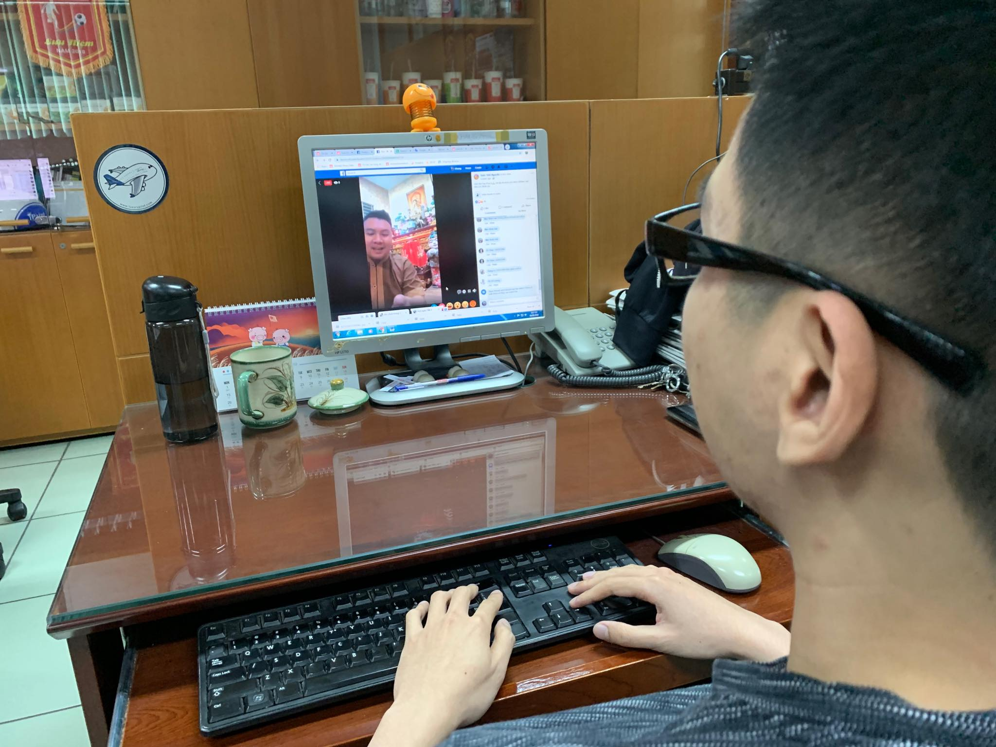 A man watches a fortune telling service on Facebook livestream. Photo: Tuoi Tre News