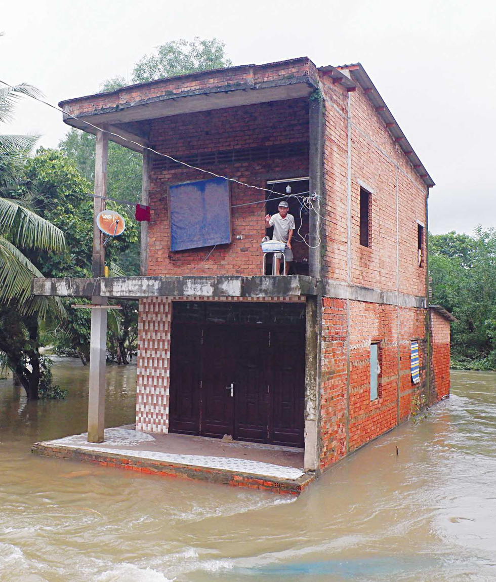 A house is isolated by floodwater.