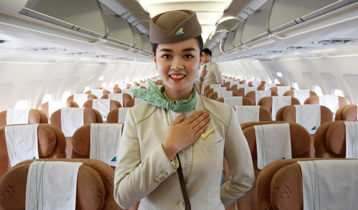 An attendee of Bamboo Airways says thanks to its passengers onboard during its flight from Ho Chi Minh city to Hanoi, Vietnam May 8, 2019. Picture taken May 8, 2019. Photo: Reuters