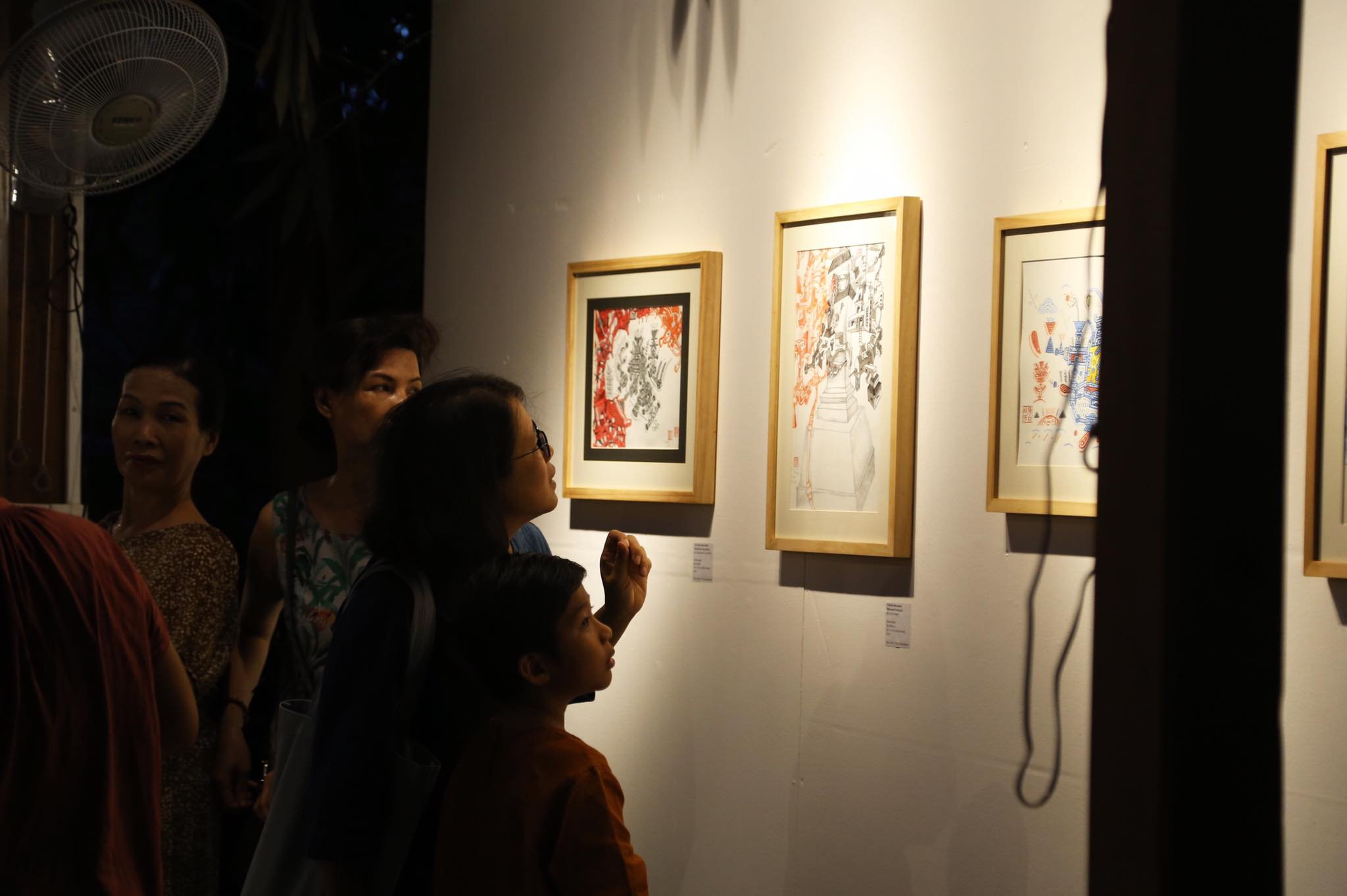 Visitors watch artworks displayed at the Molding Island City exhibition in Hoi An, central Vietnam