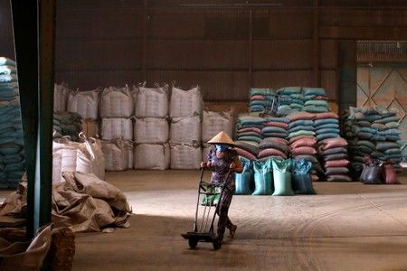 A worker is seen at a coffee warehouse of the coffee company Simexco Dak Lak Limited in the town of Di An. Photo: Reuters