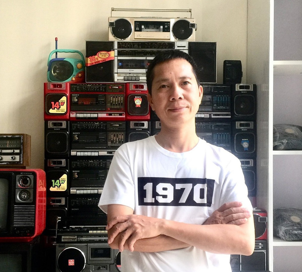 Nguyen Xuan Thuy, the president in the club of antique radio lovers, smiles in a photo taken in Hanoi with his collection. Photo: Supplied