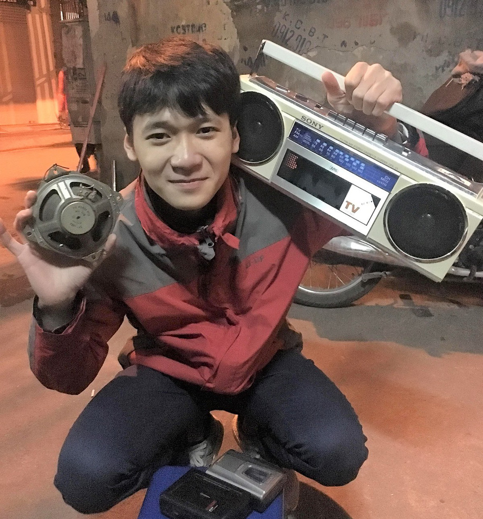 19-year-old Nguyen Dung smiles for a photo while holding his antique cassette player. Photo: Supplied