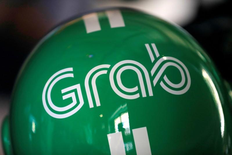 Ride-hailing firm Grab plans major investment in Vietnam: top executive