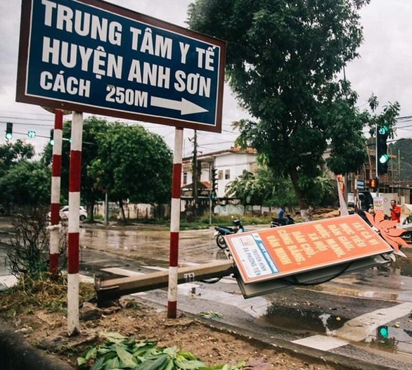A signboard in Nghe An Province is knocked down by strong gusts. Hoang Cong / Tuoi Tre