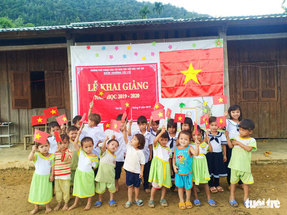 Ca Dong students pose for a photo on Ngoc Linh Mountain in Quang Nam Province, central Vietnam, September 5, 2019