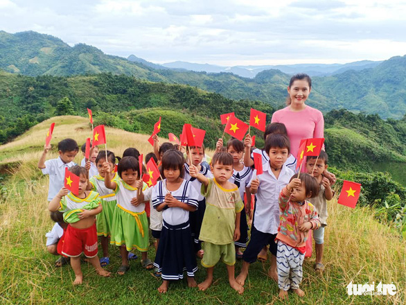 Tra Thi Thu and her students pose for a photo on Ngoc Linh Mountain in Quang Nam Province, central Vietnam, September 5, 2019