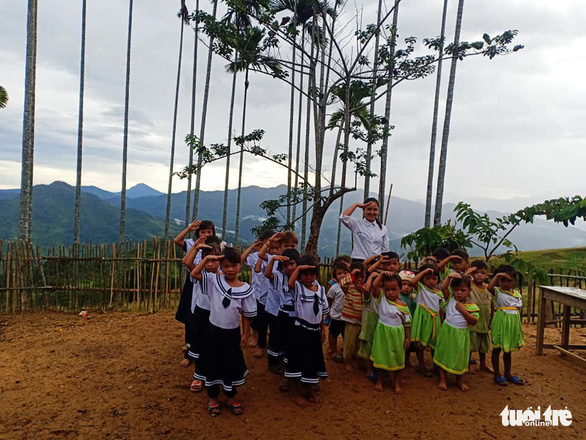 Riah Uoi and her students attend a flag-salute ceremony in Tak Po Village, on Ngoc Linh Mountain in Quang Nam Province, central Vietnam, September 5, 2019