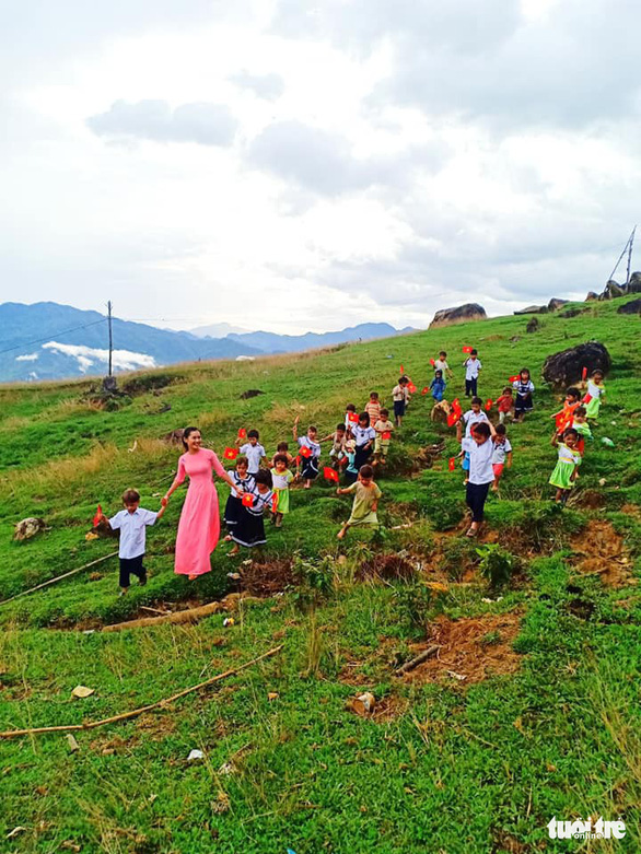 Tra Thi Thu takes her students to a hill on Ngoc Linh Mountain in Quang Nam Province, central Vietnam, September 5, 2019
