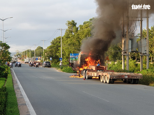 A semi-truck is seen on fire on Phu Quoc Island, off southern Vietnam, September 6, 2019. Photo: Duy Khanh / Tuoi Tre