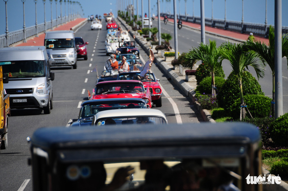 The classic cars travel on Cua Dai Bridge in Hoi An.