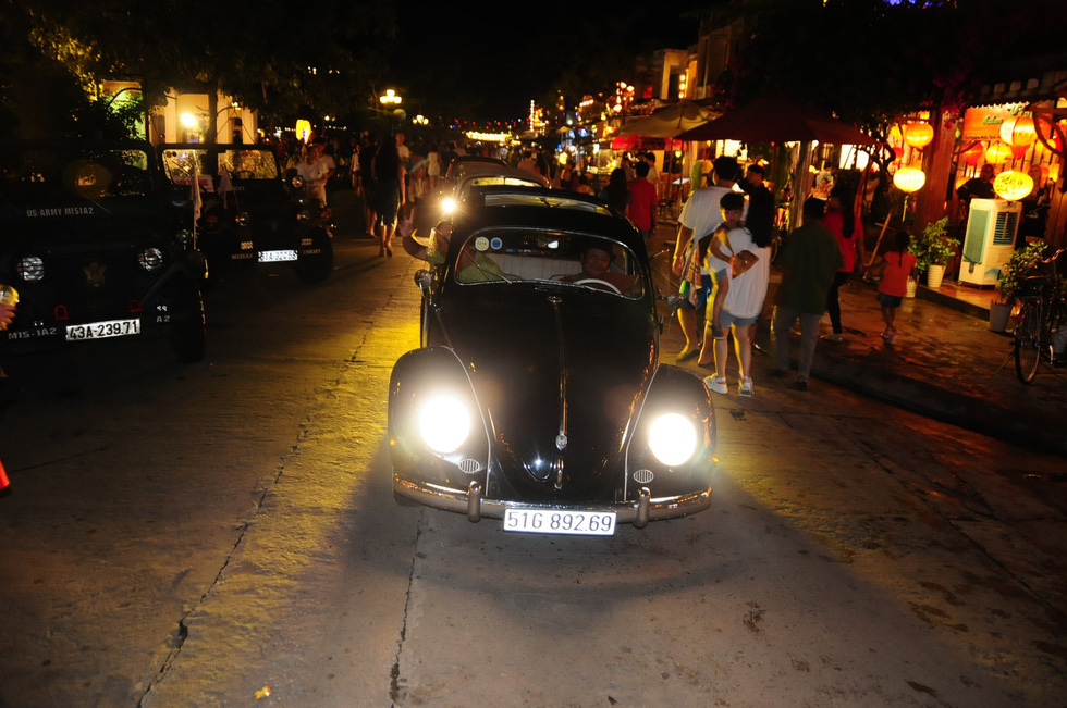 The vintage cars travel on Nguyen Phuc Chu Street, located in the heart of Hoi An Ancient Town, on the evening of September 7, 2019.