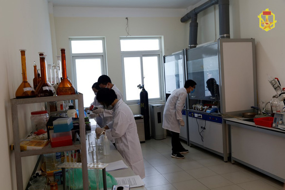 Scientists test for chemical content of samples collected from the remains of the Rang Dong Company warehouses in Hanoi. Photo: People's Army of Vietnam