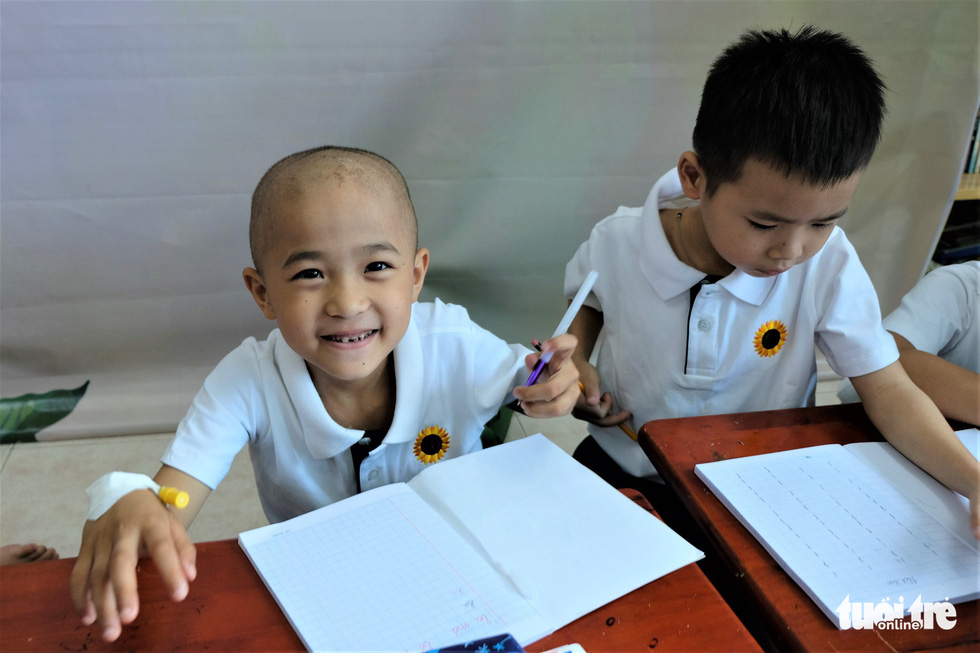 A boy with cancer smiles for a photo at his classroom at the Ho Chi Minh Oncology Hospital. Photo: Canh Toan / Tuoi Tre