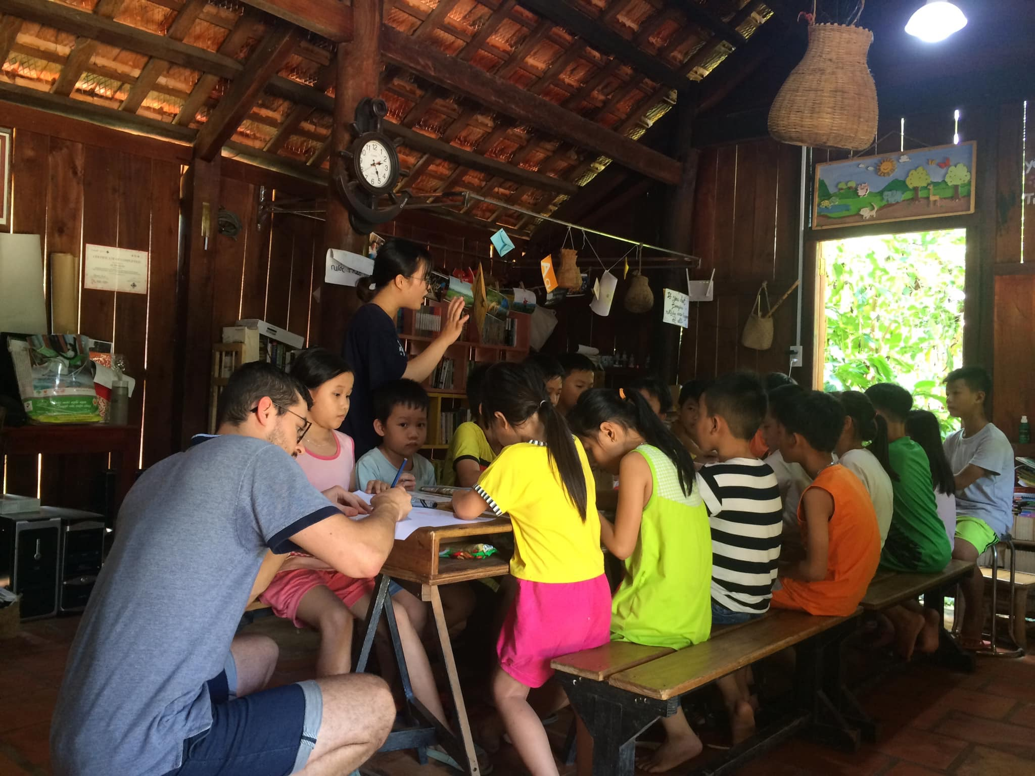 Kids learn English with trainees and volunteers. Photo: Nui Tuong Education Project