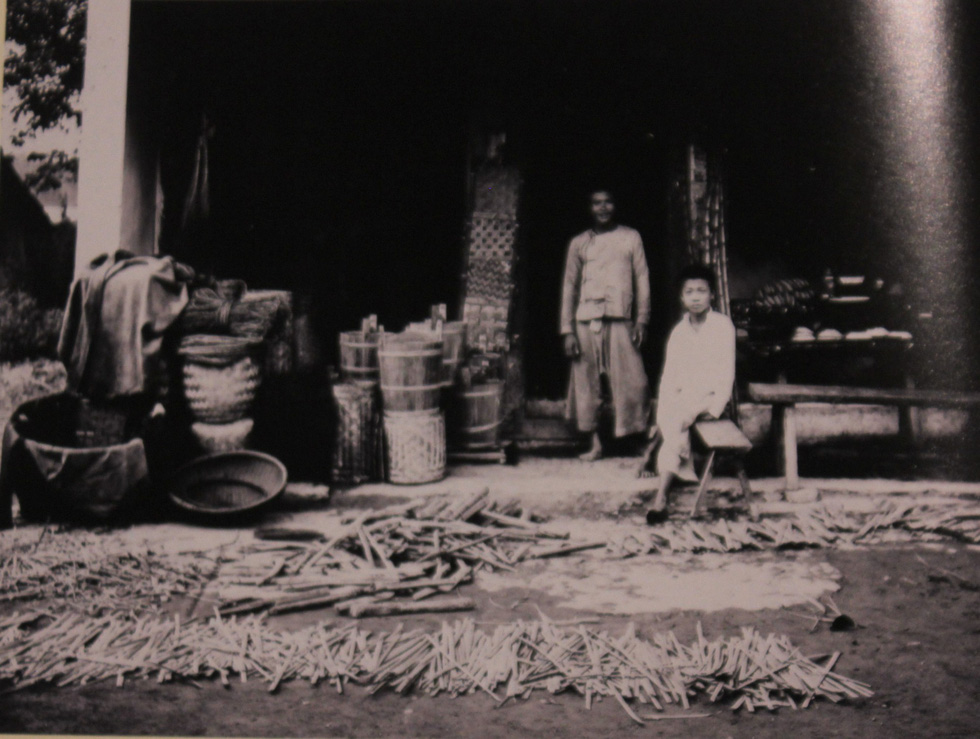 A photo capturing a bamboo craft shop in Hanoi in 20th century is displayed at an exhibition in Hanoi. Photo: Thien Dieu / Tuoi Tre