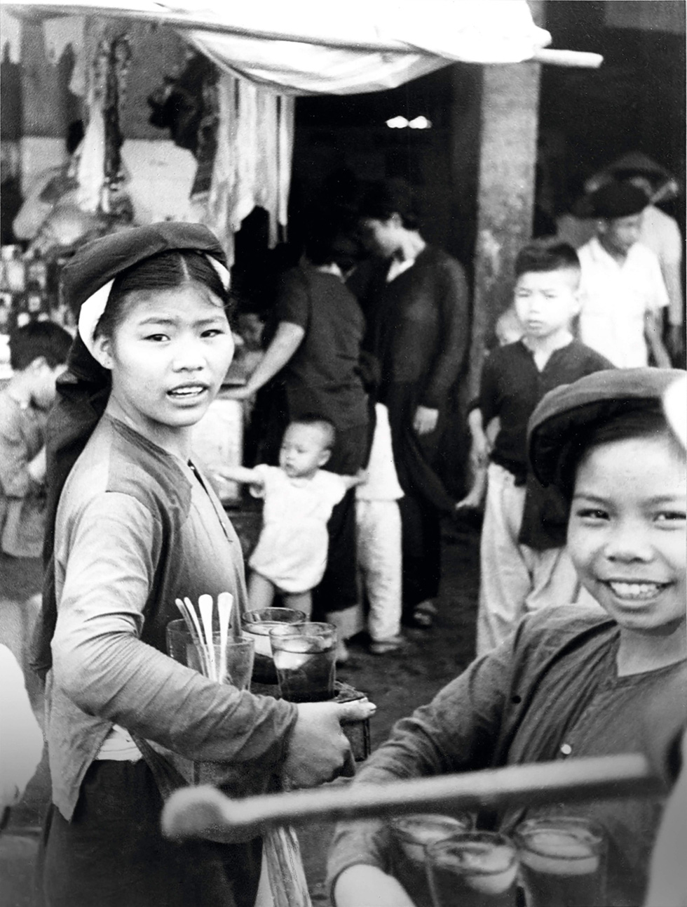A photo capturing street vendors in Hanoi in 20th century is displayed at an exhibition in Hanoi. Photo: Thien Dieu / Tuoi Tre
