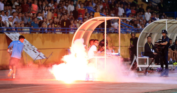 Man arrested for firing flare that injured spectator at Vietnam's league match