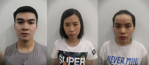 The three Vietnamese suspects are held at the police station.