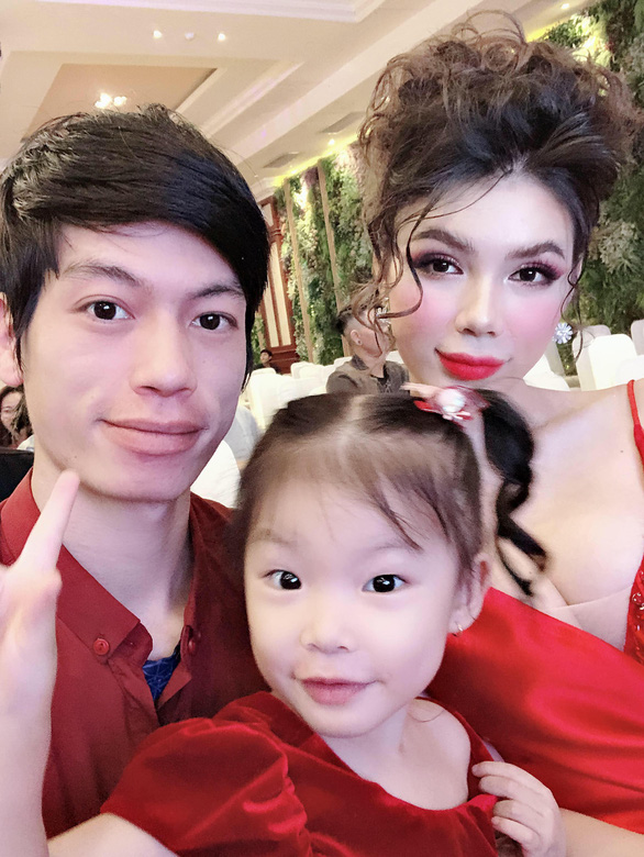 Hieu and Mi take a selfie with their adopted daughter at a party. Photo: Supplied