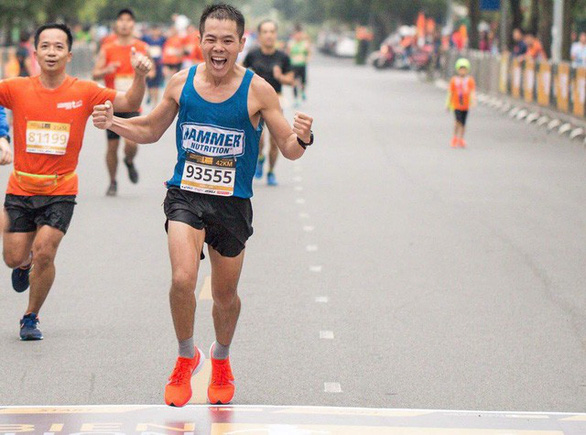 Nguyen Tien Hung runs at a marathon event in this photo uploaded on his Facebook account