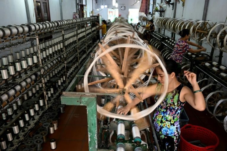 The final silk threads produced in Co Chat village in Vietnam are sold to traders exporting to Laos and Thailand. Photo: AFP