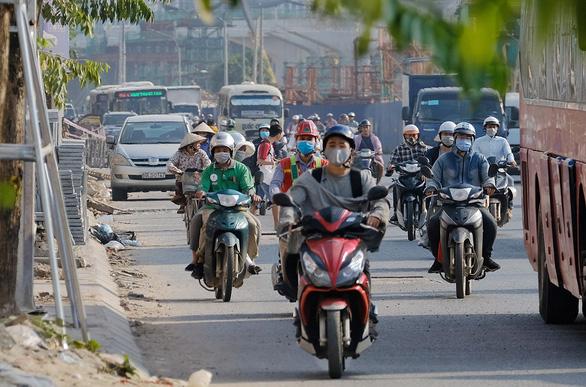 Commuters travel on Pham Van Dong Street in Hanoi. Photo: Nam Tran / Tuoi Tre