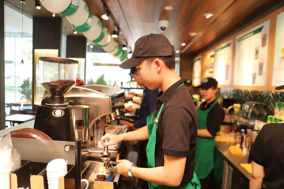 A barista prepares drinks at a Phuc Long coffee and tea store in this photo posted to the company's Facebook page on April 12, 2019.